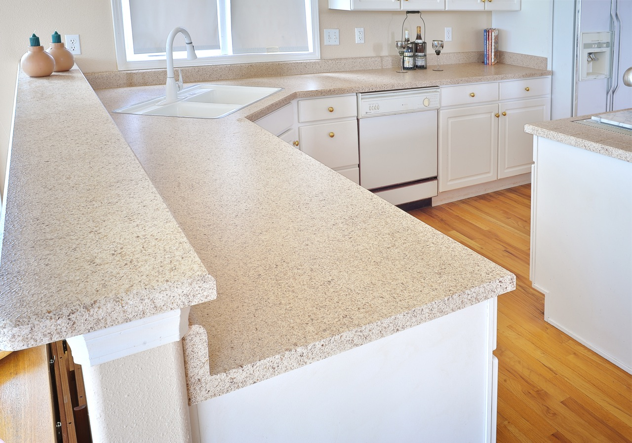 After: The kitchen countertops refinished in a more classic color.